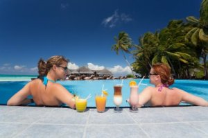 woman in pool with drinks